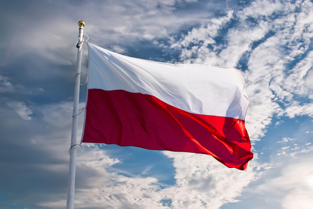 polish flag waving against blue sky Stockfoto