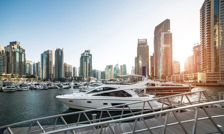 city landscape: view with modern skyscrapers and water pier of Dubai Marina, United Arab Emirates Stock Photo