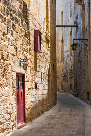 alley: traditional narrow silent street in Maltese Mdina