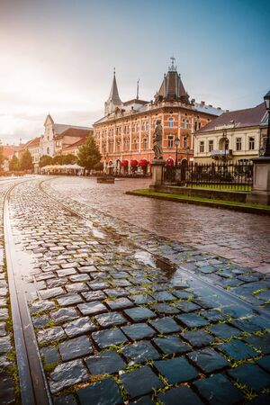 paving stone: central square in Kosice with tram rails and paving stone after rain
