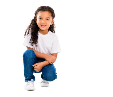 knelt: smiling little cute girl knelted on one knee isolated on white backgorund Stock Photo