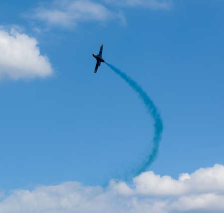 plane with colorful trail in the sky at Kharkiv airshow