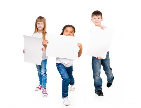 blanks: three funny children holding paper blanks in hands isolated on white background