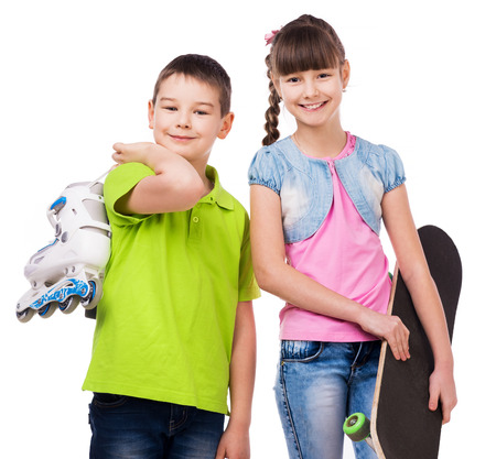 two children: smiling boy and girl with skate and rollers isolated on white background Stock Photo