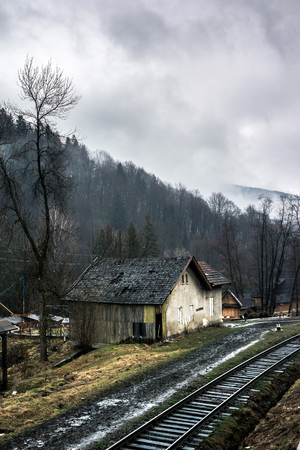 carpathian mountains: beautiful landscape with old house by railroad in Carpathian mountains, Ukraine