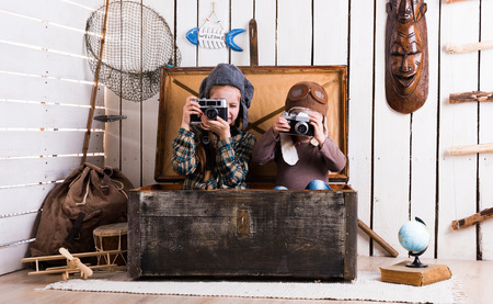 rarity: two little girls in hats in big wooden chest playing rarity cameras
