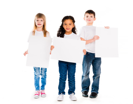 children hands: three funny children holding paper blanks in hands isolated on white background