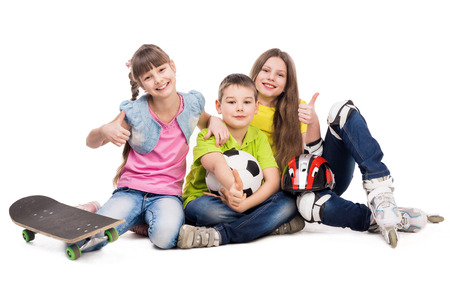 boy lady: laughing schoolchildren with sport equipment on the floor isolated on white background