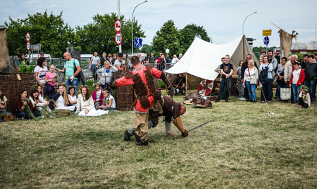 showmanship: Warsaw, Poland - 8 March 2015:  traditional fights on midsummer holiday fest Editorial