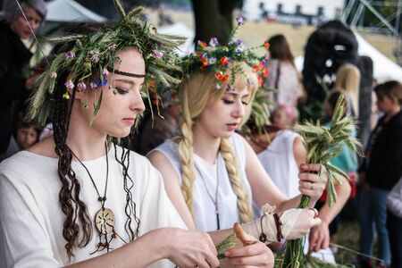 flower head: Warsaw, Poland - 20 June 2015: girls with herbal wreaths on midsummer holiday