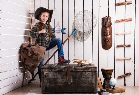 net book: cute little girl in cowboy hat  carrying backpack and net in decorated room