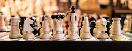 chessman: wooden white and black chess on board Stock Photo