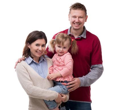 foto de la madre, el padre y la hija de la familia aislada en el fondo blanco Foto de archivo