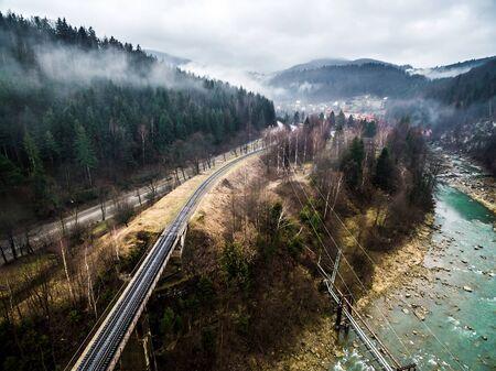 carpathian mountains: misty view on railroad bridge in Carpathian mountains, Ukraine Stock Photo
