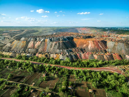 dumps: beautiful landscape with multicolored rock dumps from quarries, aerial photo Stock Photo