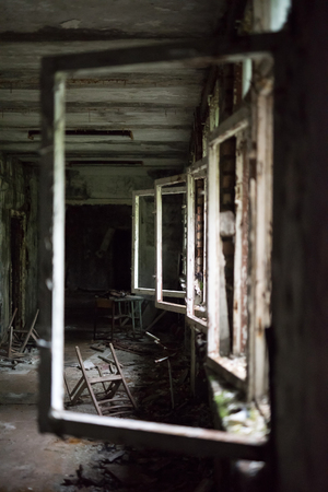 forsaken: school room with turned chairs and opened window frames in Pripyat, Chernobyl, Ukraine Stock Photo