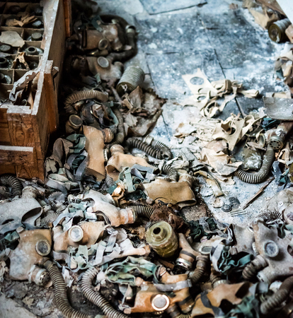 abandoned room: abandoned school room with trash and masks on the floor in Pripyat, Chernobyl, Ukraine Stock Photo