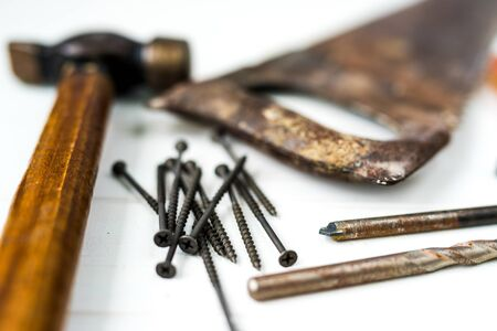 different carpenters and mechanics tools on a white wooden table