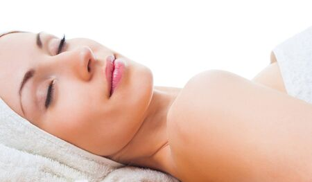 spa woman: beautiful woman with closed eyes lying on table in spa
