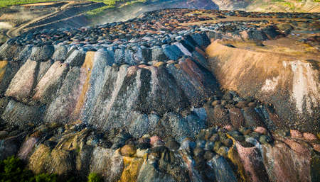 dumps: landscape with multicolored rock dumps from quarries, aerial photo