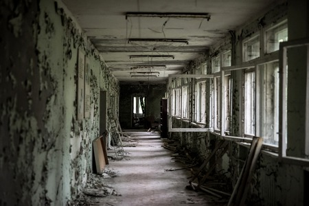 school room with turned chairs and opened window frames in Pripyat, Chernobyl, Ukraine Stock Photo