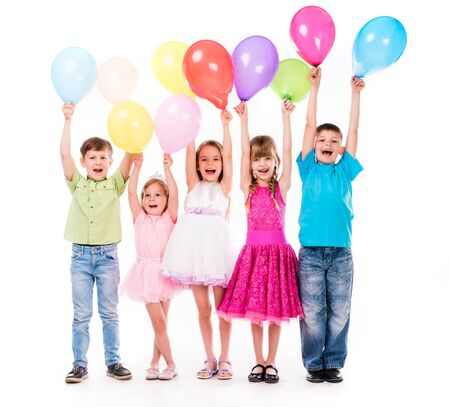 baloons: cute little children laughing with hands up and colorful baloons