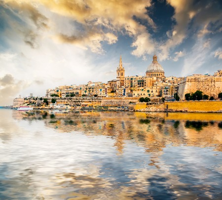 scenic View of Marsamxett Harbour and Valletta in Malta at sunset with reflection Stok Fotoğraf