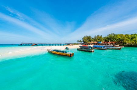colorful exotic seascape with boats near Zanzibar shore in Africa Фото со стока - 77658252