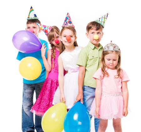 young boys: funny children with clown noses and birthday hats standing one by one