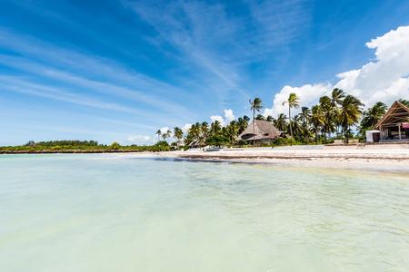 beautiful view of Zanzibar island and blue sky from ocean Фото со стока