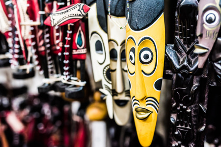 rite: many colorful african traditional masks at a market Stock Photo