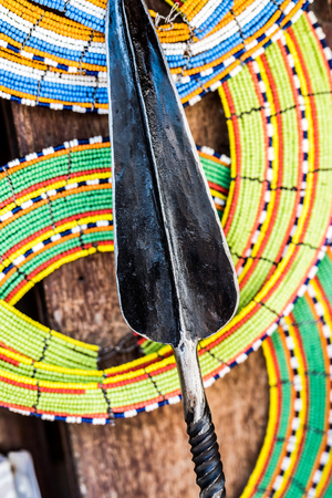 tnational african handmade colorful decorations and tribal spear on Zanzibar market