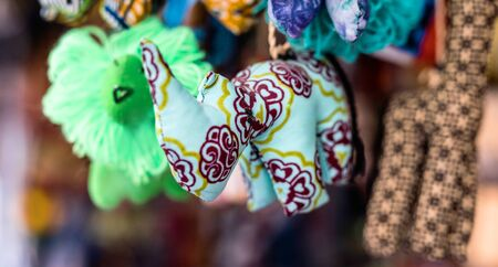colorful sewn fabric toys at african souvenir market Stock Photo