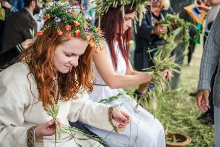 Warsaw, Poland - 20 June 2015: girls with herbal wreaths on midsummer holiday