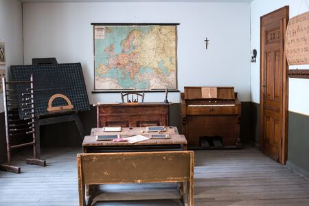 silla de madera: Budapest, Hungary - July 08, 2015: exhibition area stylized as classroom with map in Hungarian National Museum