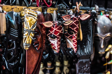 different colorful wooden african masks at market Stock Photo