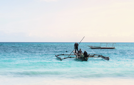 beautiful colorful seascape with fishing boats and fishermen, Zanzibar Stock Photo