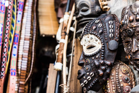 traditional african wooden carevd tribal masks at market 스톡 콘텐츠