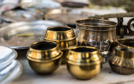 antique vase: Polished old eastern copper tableware for sale as antiques Stock Photo