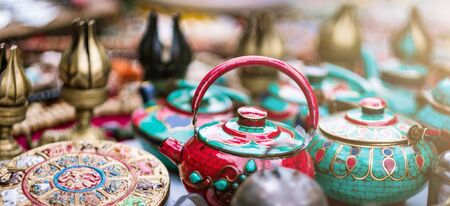 Traditional colorful ceramic teapots and tableware sale on nepalese street market