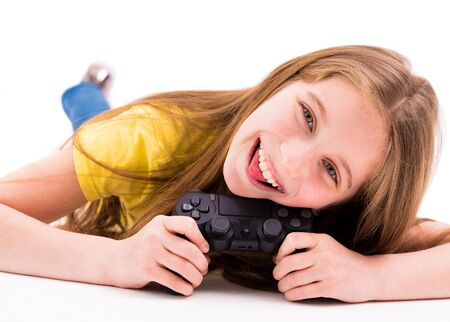 Cute long haired girl lying on the floor with a joystick, tired from playing games