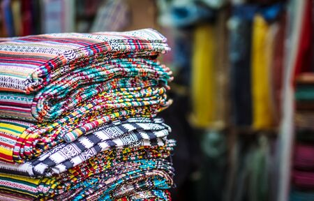 stack of traditionan asian fabric at Nepalese market