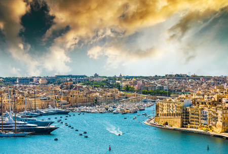 beautiful panoramic view on Valletta from the sea in Malta at sunset
