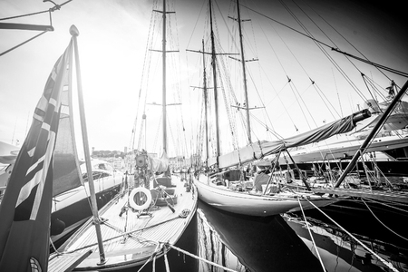 Beautiful marina view, sailboats and motorboats in port. Photo in black and white