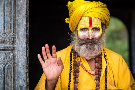 Kathmandu, Nepal - 06 October 2017: sadhu in colourful clothes and painted face in Kathmandu city, Nepal Editöryel