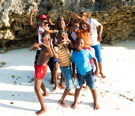 Zanzibar, Tanzania - July 09, 2016: Boys living on Zanzibar. wearing bright colorful clothes