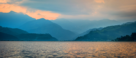 Panoramic view of Phewa lake and silhouette of mountains on the background, Nepal
