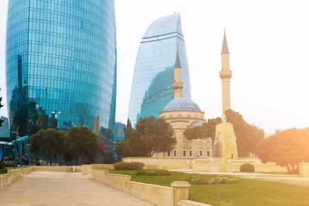 Famous flame towers of Baku on a cloudy day. Skyscrapers over grey sky, Baku, Azerbaijan