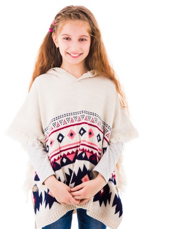 Beautiful young teen girl with long hair wearing knitted poncho isolated on white background Banque d'images