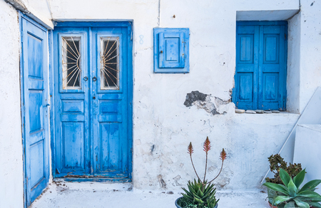 old blue doors and windows in old house at island Mykonos